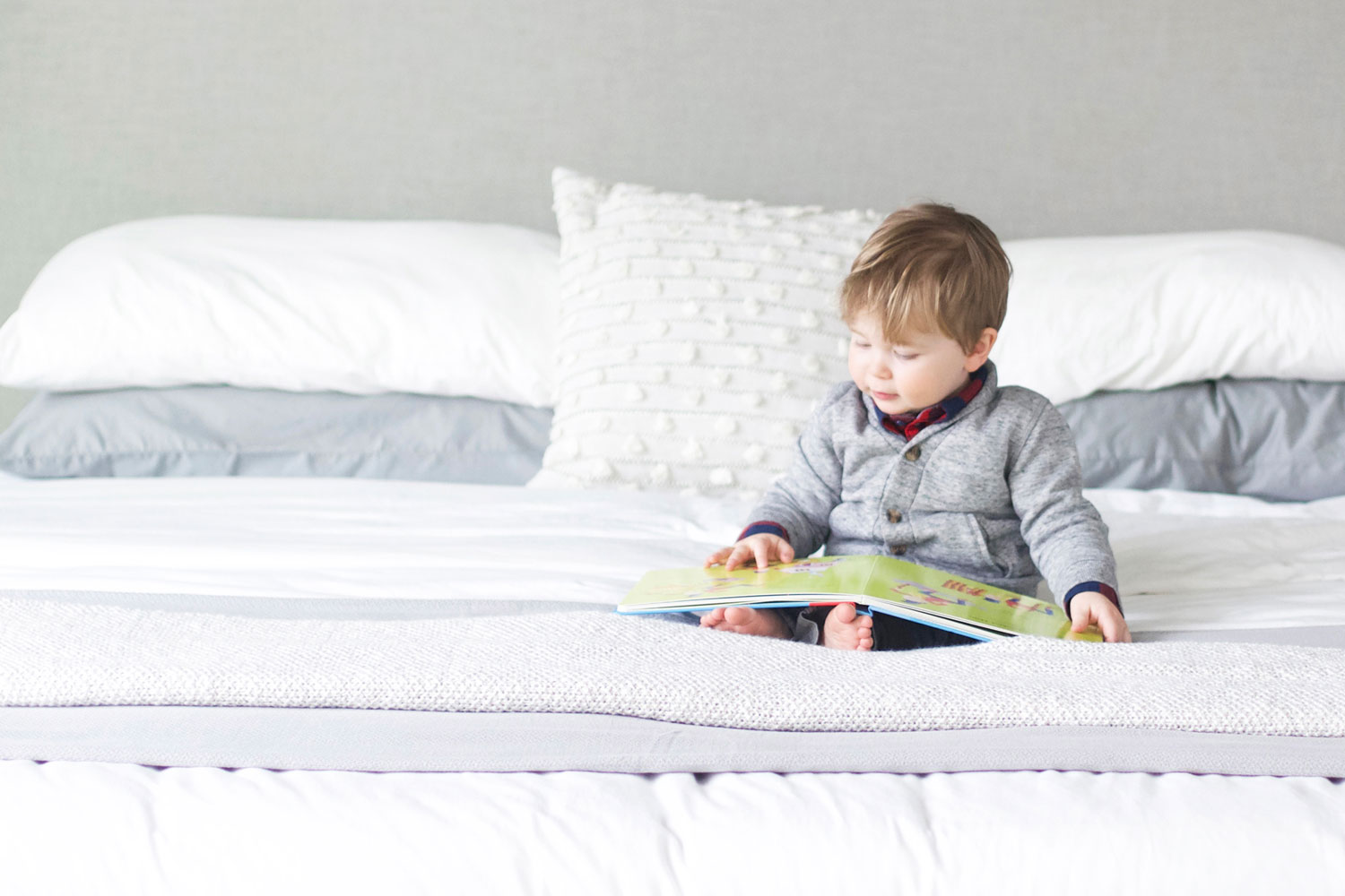kid reading in bed - master bedroom tour