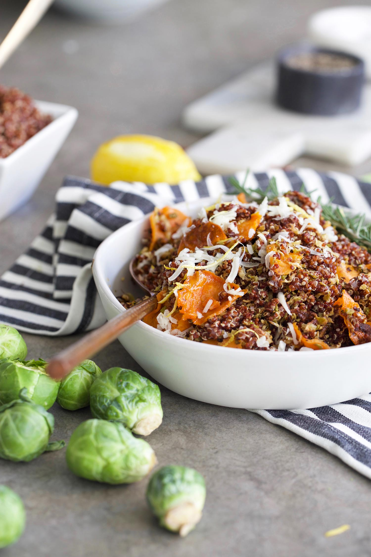 crispy Brussels sprouts with quinoa and sweet potatoes in a bowl