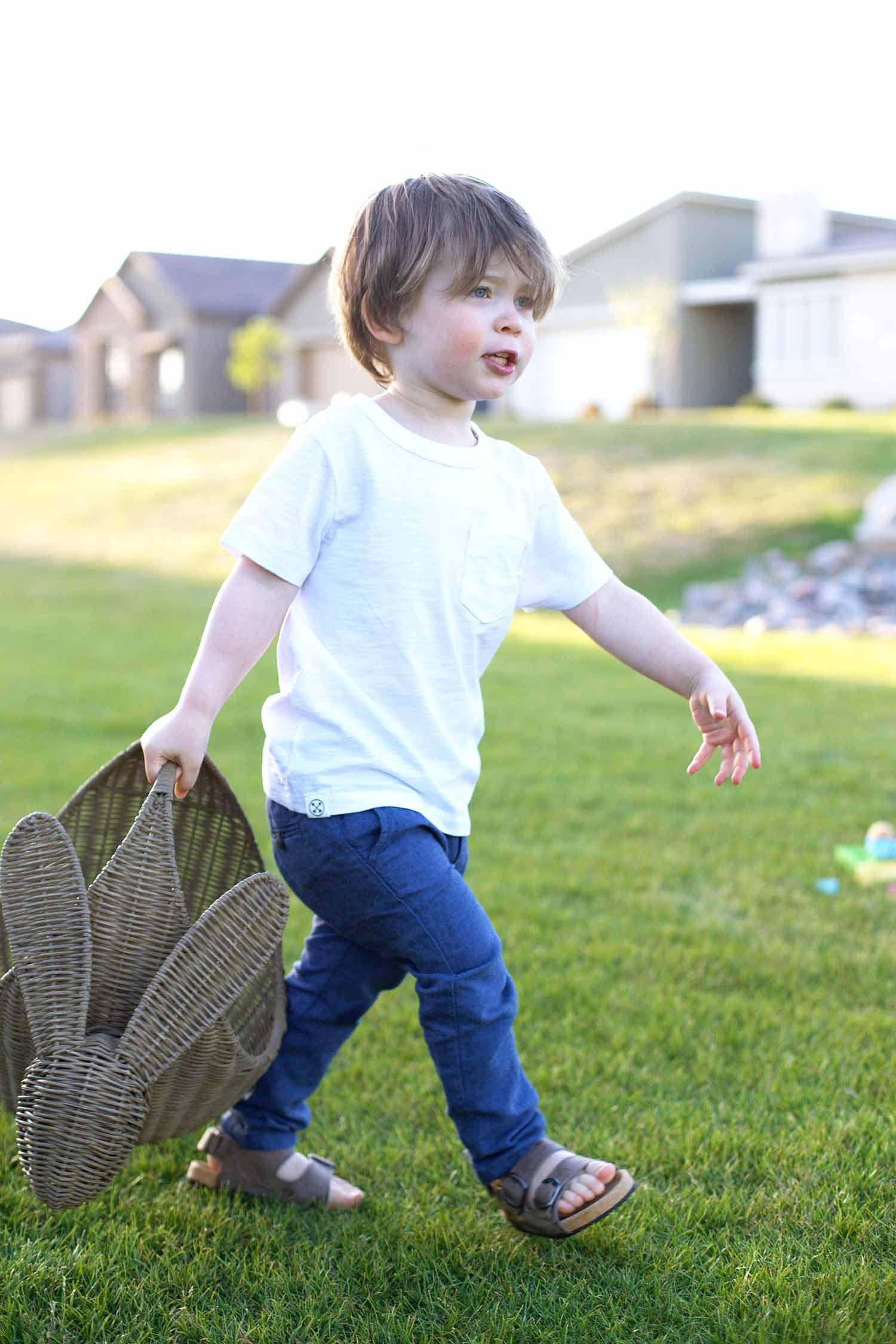 Easter picnic toddler boy walking with Easter basket