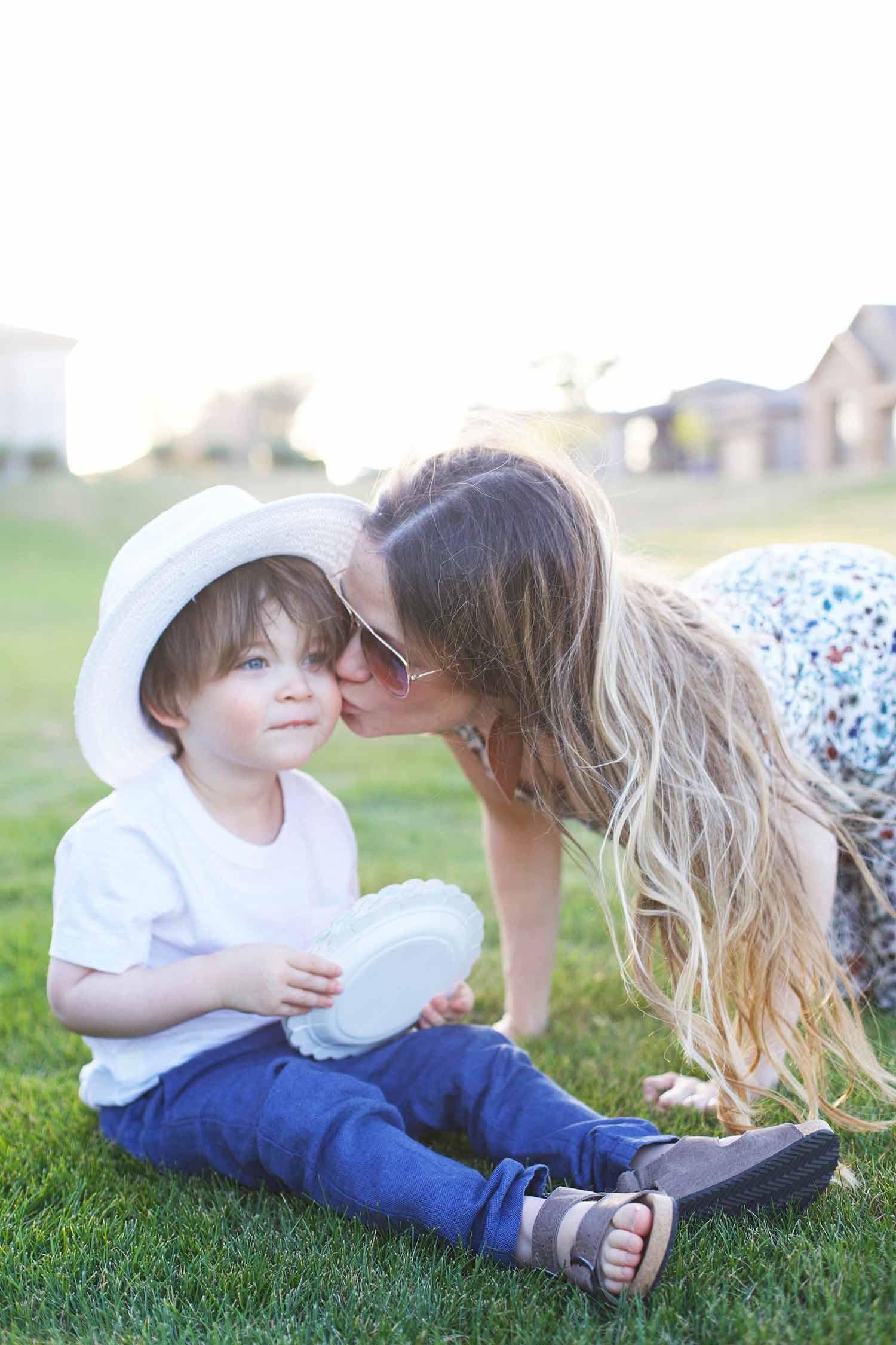 Easter picnic mom kissing son