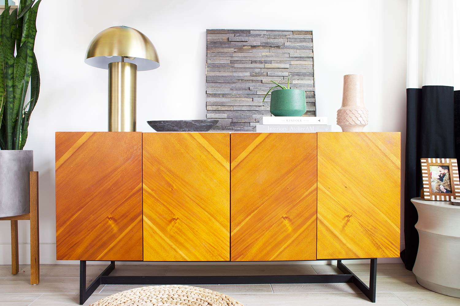 credenza featuring Stikwood wall art