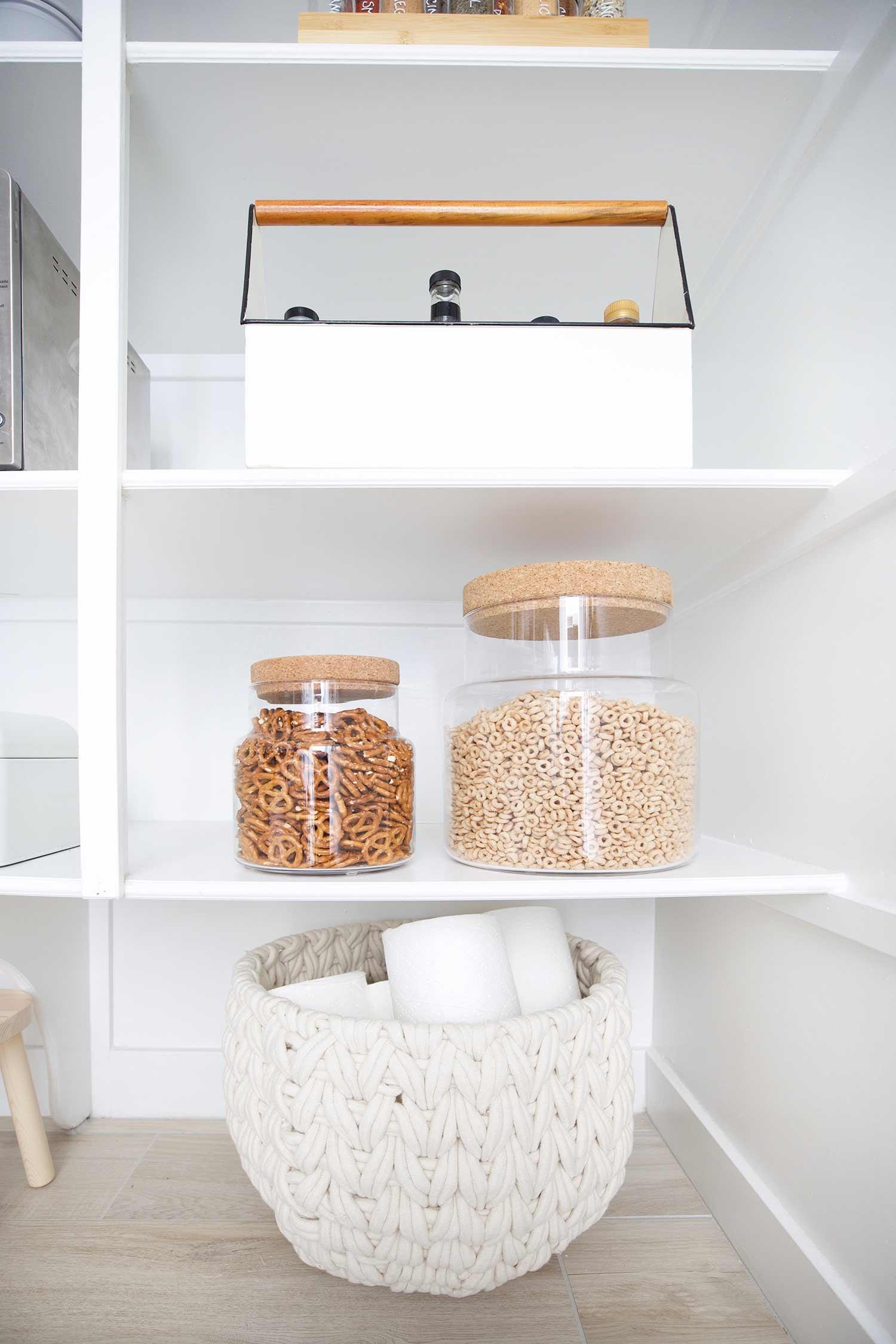 large snack jars in organized pantry