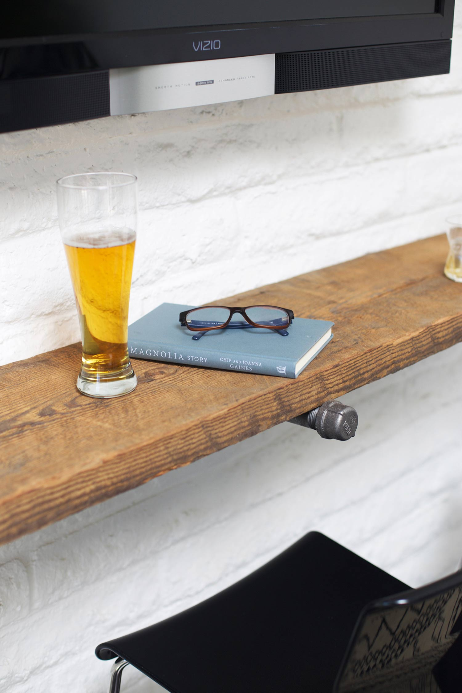 reclaimed wood shelf bar with drink and book