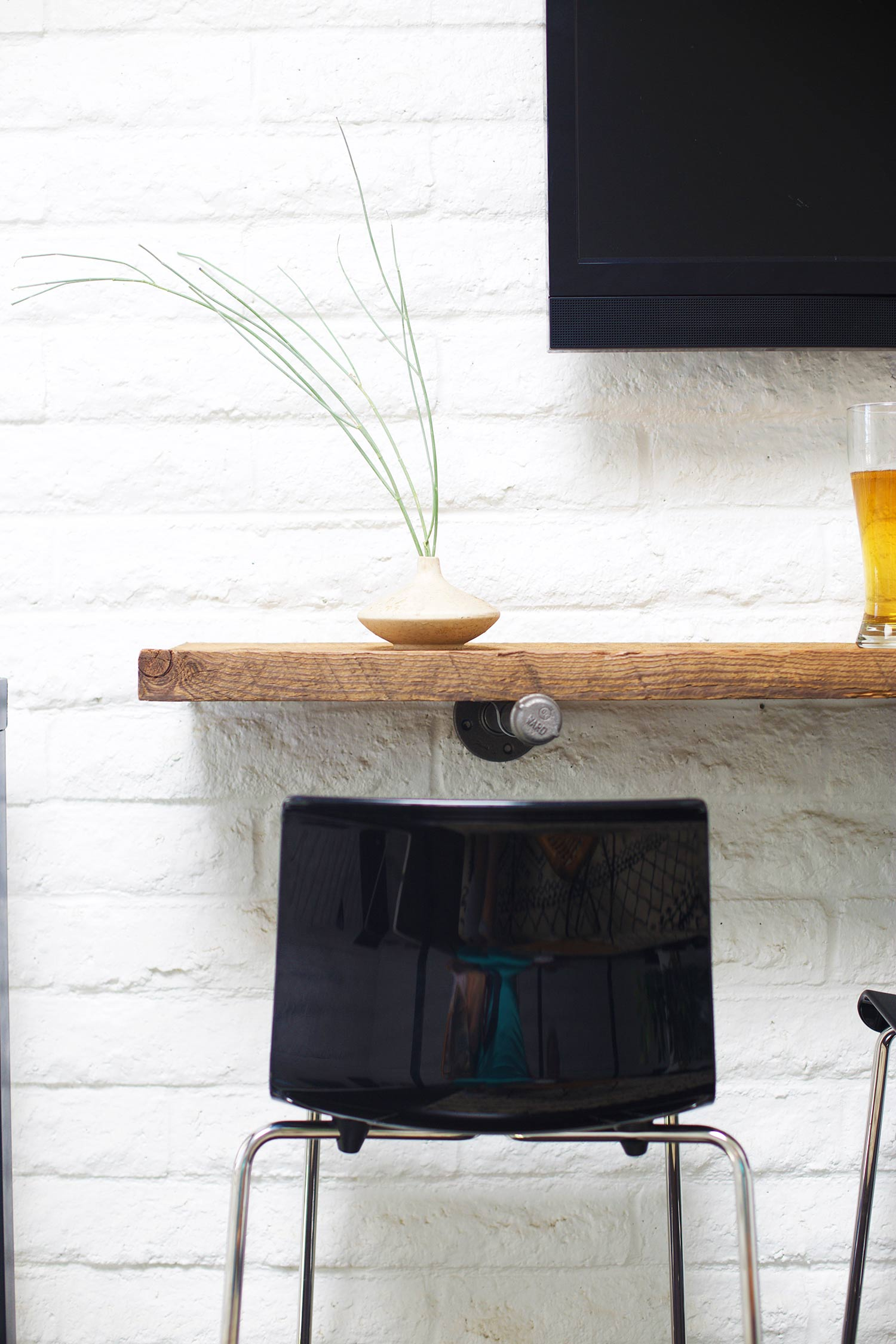 reclaimed wood shelf bar with barstool