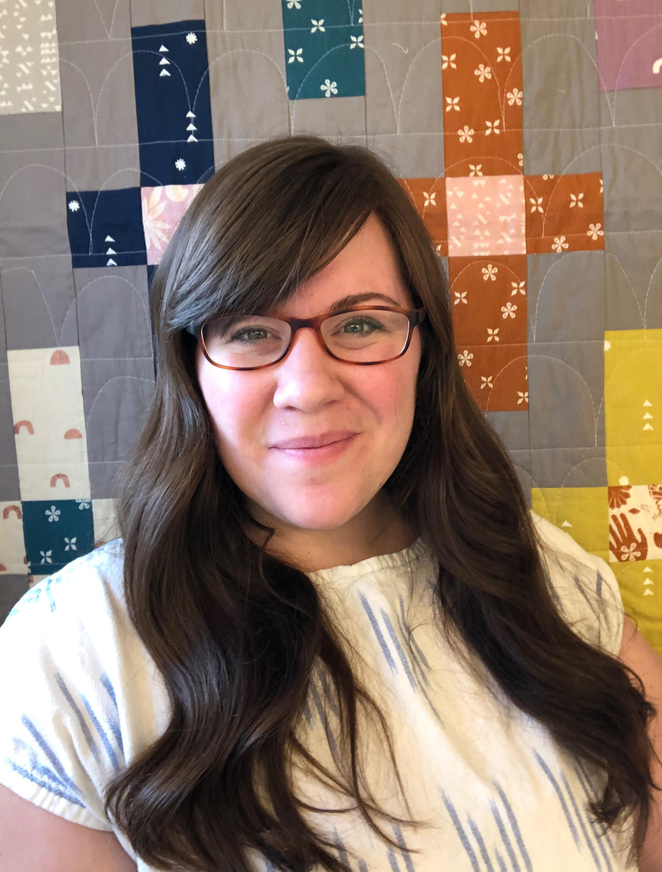 Kristin Rauch of Woolly Petals, in front of her new Moonrise quilt - pattern available in her Etsy shop