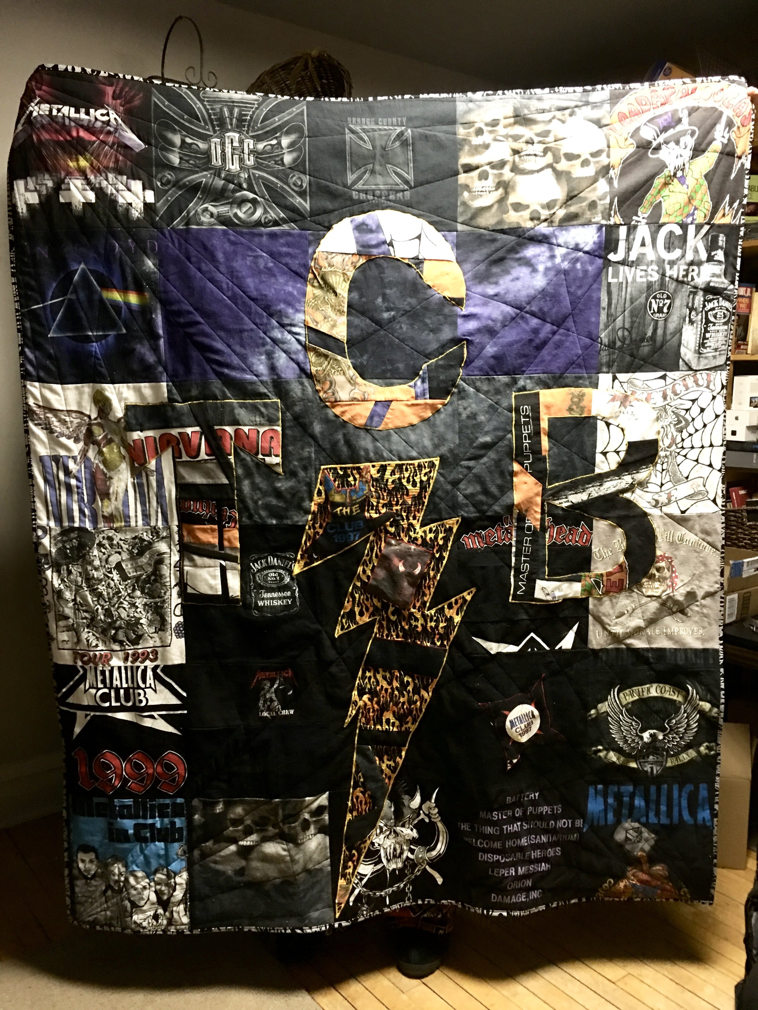 Metal Rock t-shirt quilt I made for my husband from his t-shirts and machine quilted with Christa's radiating lines technique from her book  Machine Quilting with Style