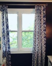 My office ikea drapery panels I hemmed and installed onto nice decorative hardware