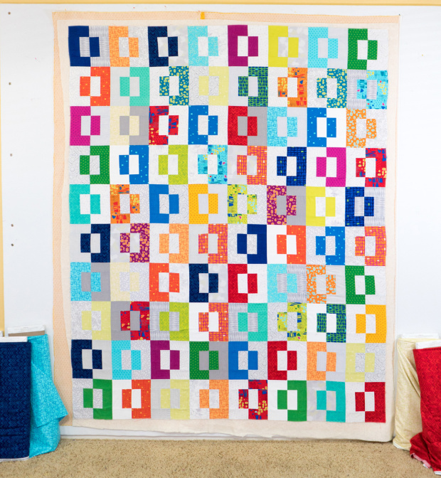 Click photo for Christa's tutorial on wall spray basting quilts