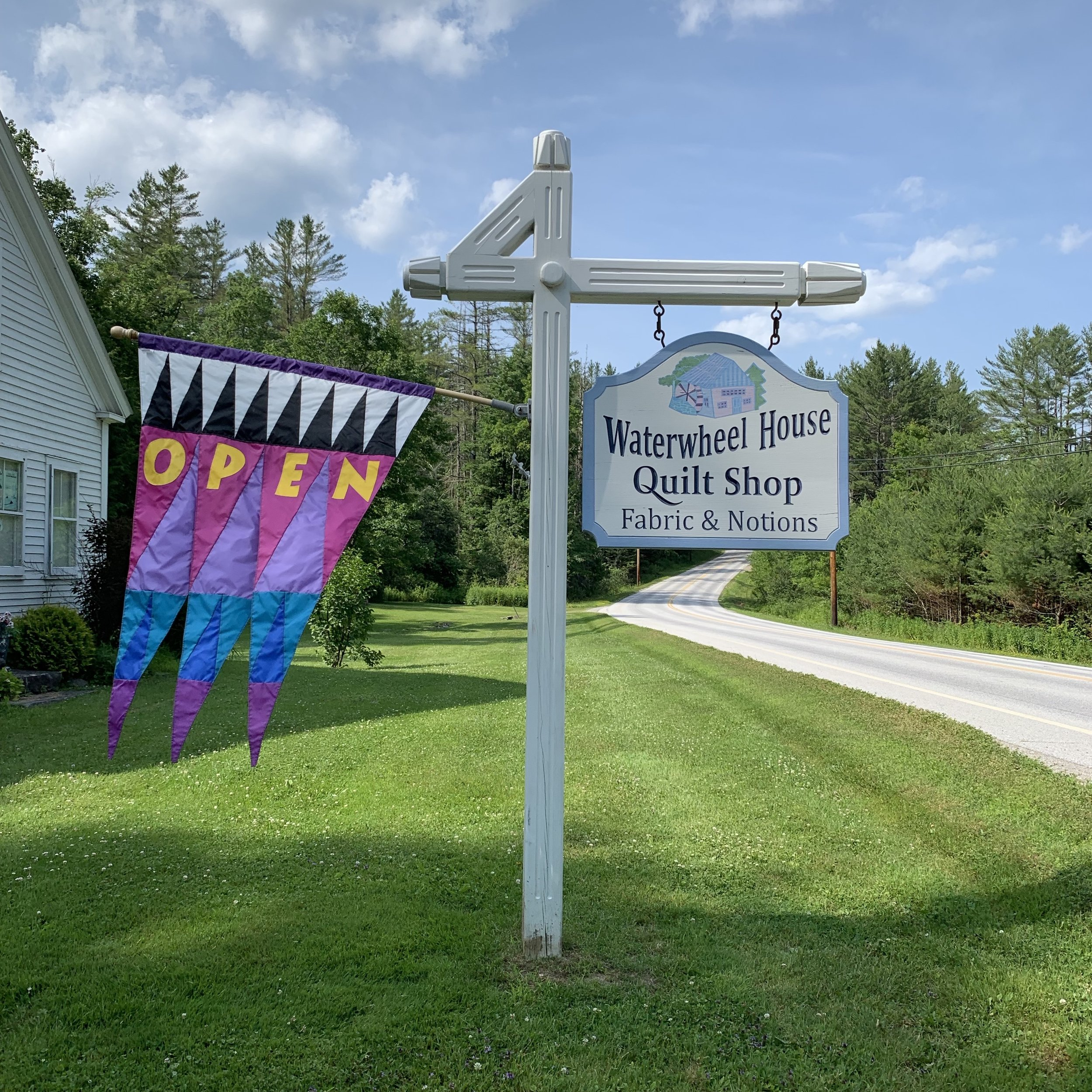 Sign in front of Waterwheel House Quilt Shop