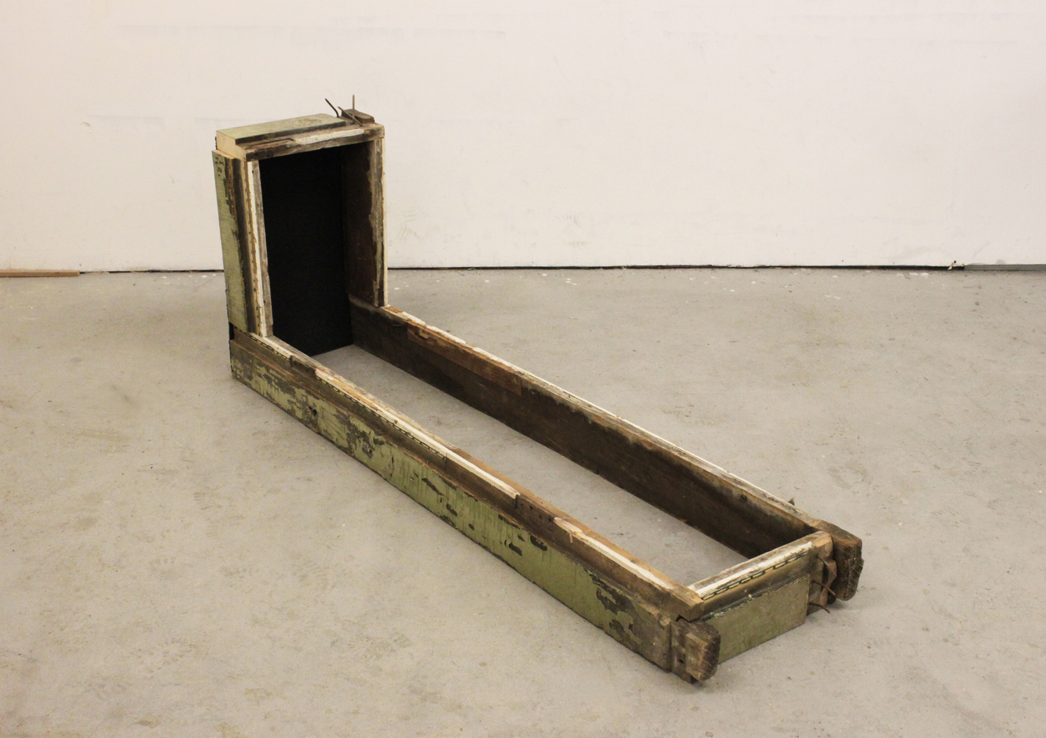"""Soo Shin\ Lying Here/There\ h 15"""" w54"""" d 12""""\ found  wood beams, rubber\ 2012"""