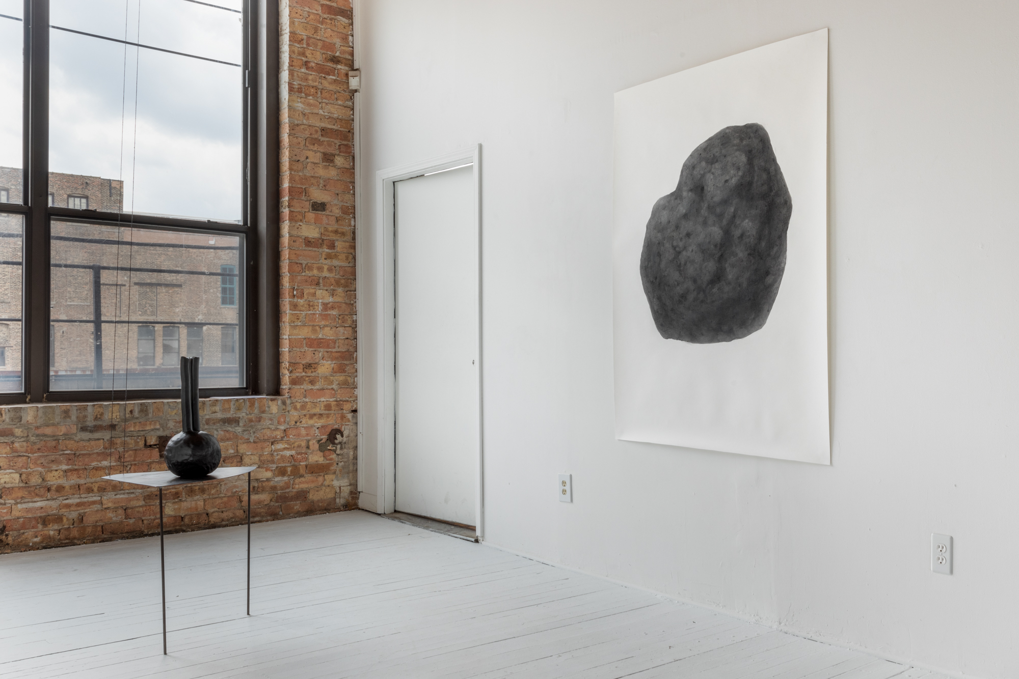 """Soo Shin, Install view of 'A Collection of Tears 2012-Present' at Bar 4000 Gallery, 2019  (right_Soo Shin\Enlargement of Concrete Tear) \ graphite and charcoal on paper\ h 68"""" w 48""""\ 2019 (Photo credit Bar4000/Evan Jenkins)"""