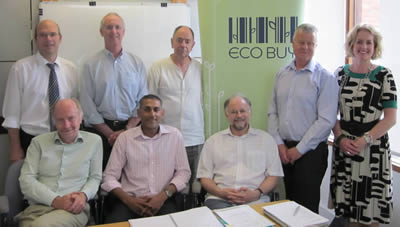 ECO-Buy Board, staff and Net Balance Director Terence Jeyaretnam  following the final signing of documents to complete the merger.    (From left to right - Back row: ECO-Buy CEO Hugh Wareham, Mick Ulbrick,  Chair Mike Hill, John Nolan, Company Secretary Caroline Bayliss. Front row:Bill  Forest, Terence Jeyaretnam, Alan Pears)