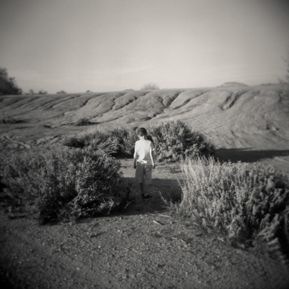 04/28 – Maddox in the Desert   Gelatin Silver Print on Ilford Warmtone Fiber Paper © 2014,Gina DeGideo