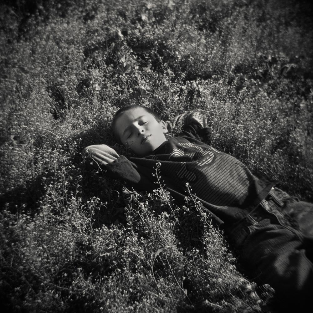 03/31 – Maddy in the Grass   Gelatin Silver Print on Ilford Warmtone Fiber Paper © 2014,Gina DeGideo