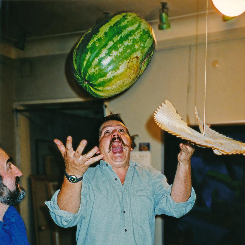 """Sergei Semenov's Suspended Watermelon,1998  24"""" x 24"""""""