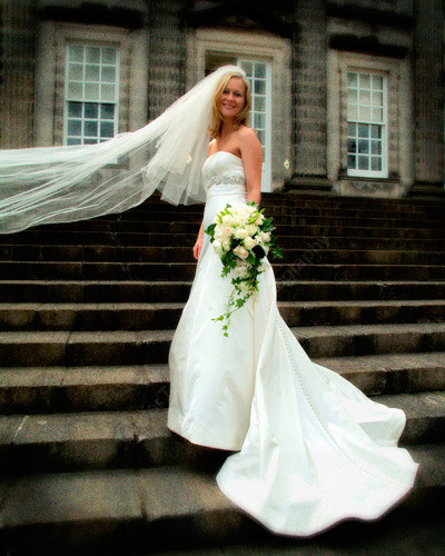 """Hopetoun House Wedding                Bridal portrait on the steps outside Hopetoun House near Edinburgh, this allows the dress train to flow well.  """"Looking through the pictures, we are having trouble choosing the best prints as they are all so good!.....  We are so thrilled with the pictures and are so glad that we made the decision to go with you...""""  Frances, London"""
