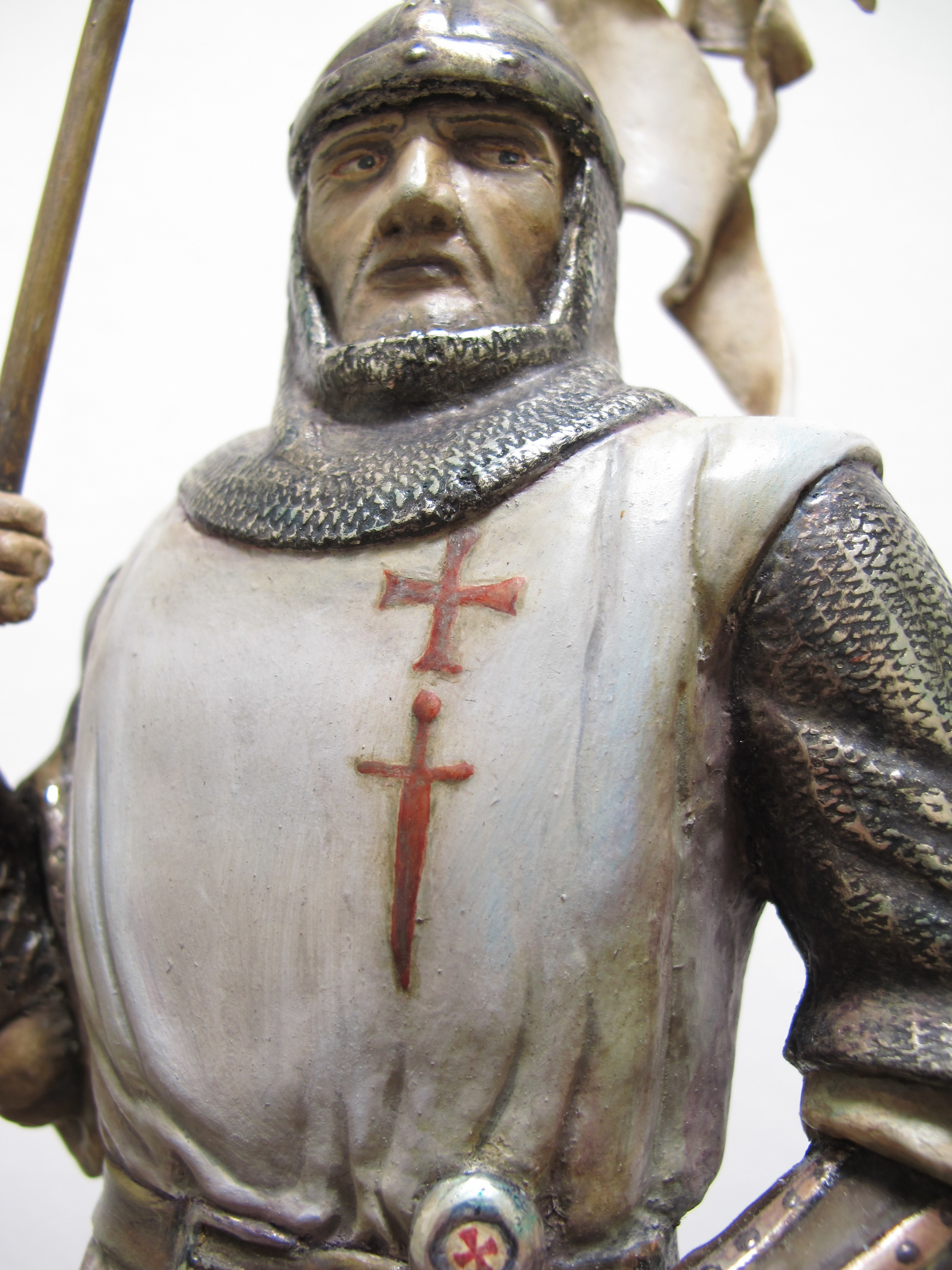 This hand-carved knight represents the historic figure of a Teutonic Knight from the thirteenth century. The chain mail and all other metal details are gilded with white gold that has been varnished and patinated. Special care has been given to the painting of the face and the hands.