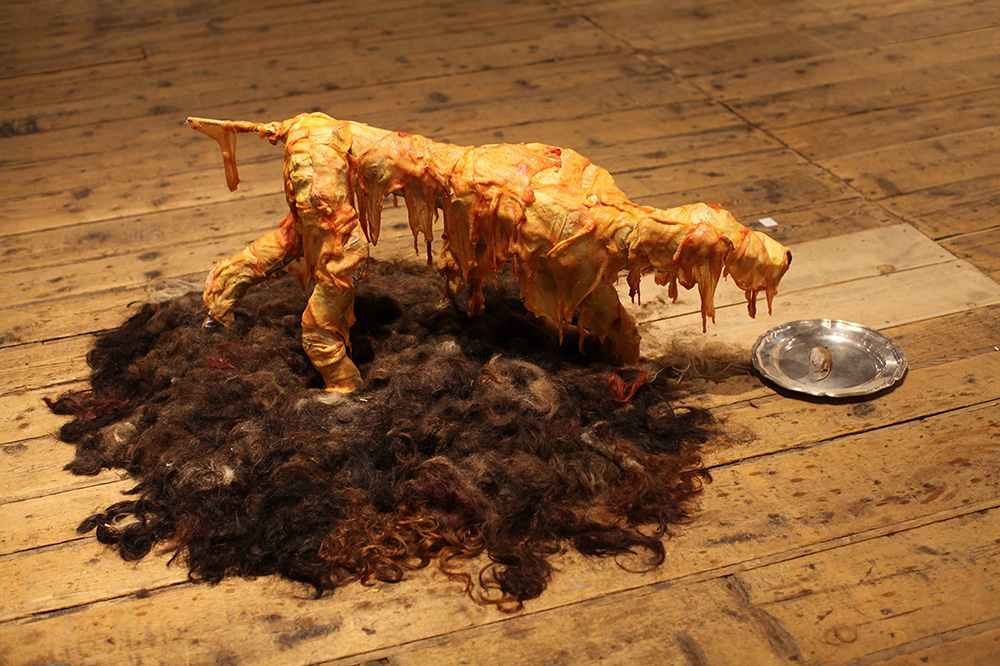untitled,  chicken skin, human hair, 2012
