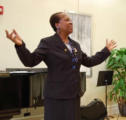 Dr. Grace Hackett-Faroul, Voice