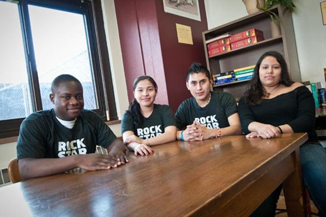 Koffi Kagni, Elioenai Gonzalez, Giovani Olivares, and Deborah Soriano — students at Roosevelt High who meet with RSS tutors  Photo by Bill Kelley