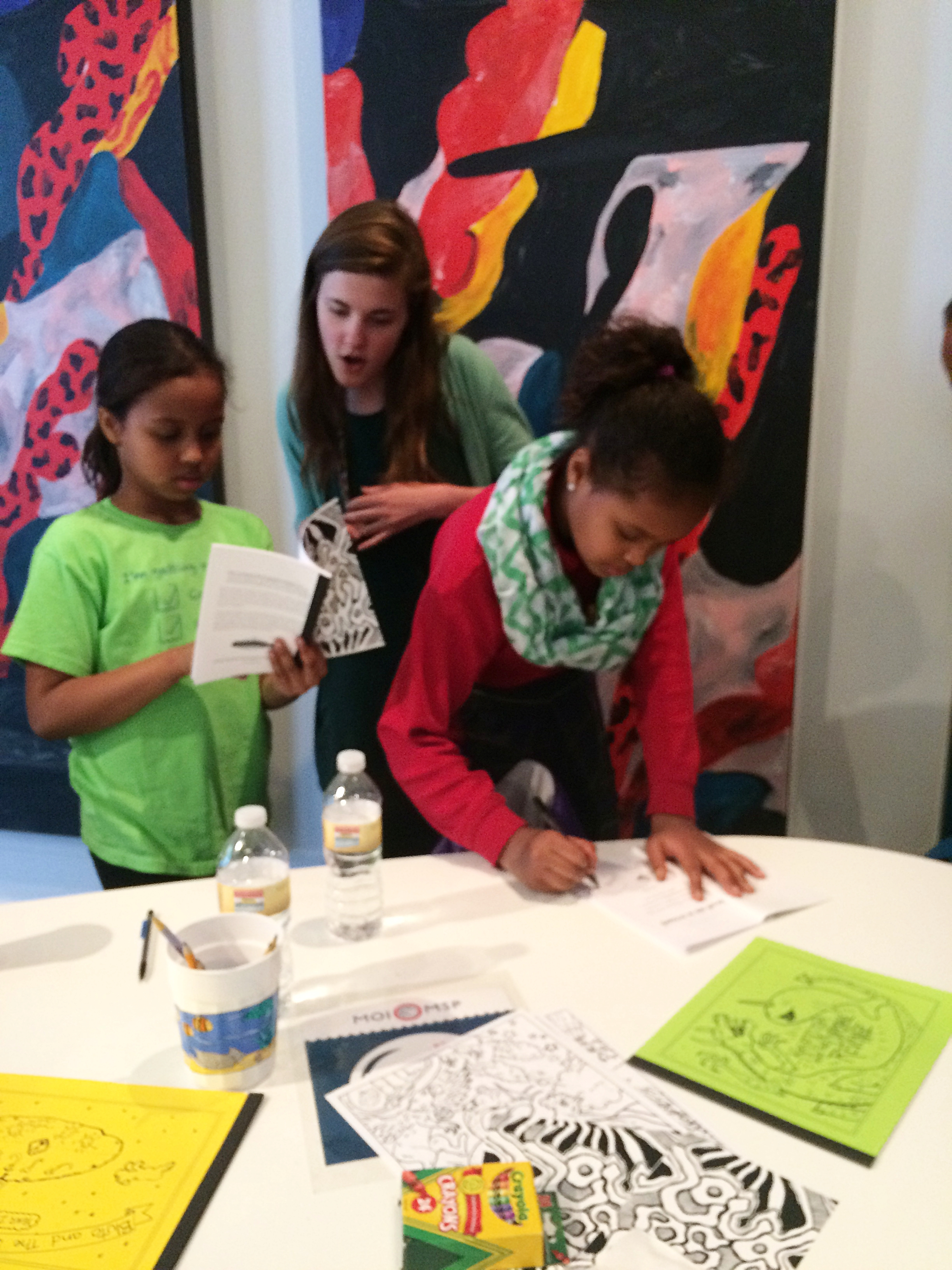 Student authors autographed their published stories in  Loud as a Crowd .