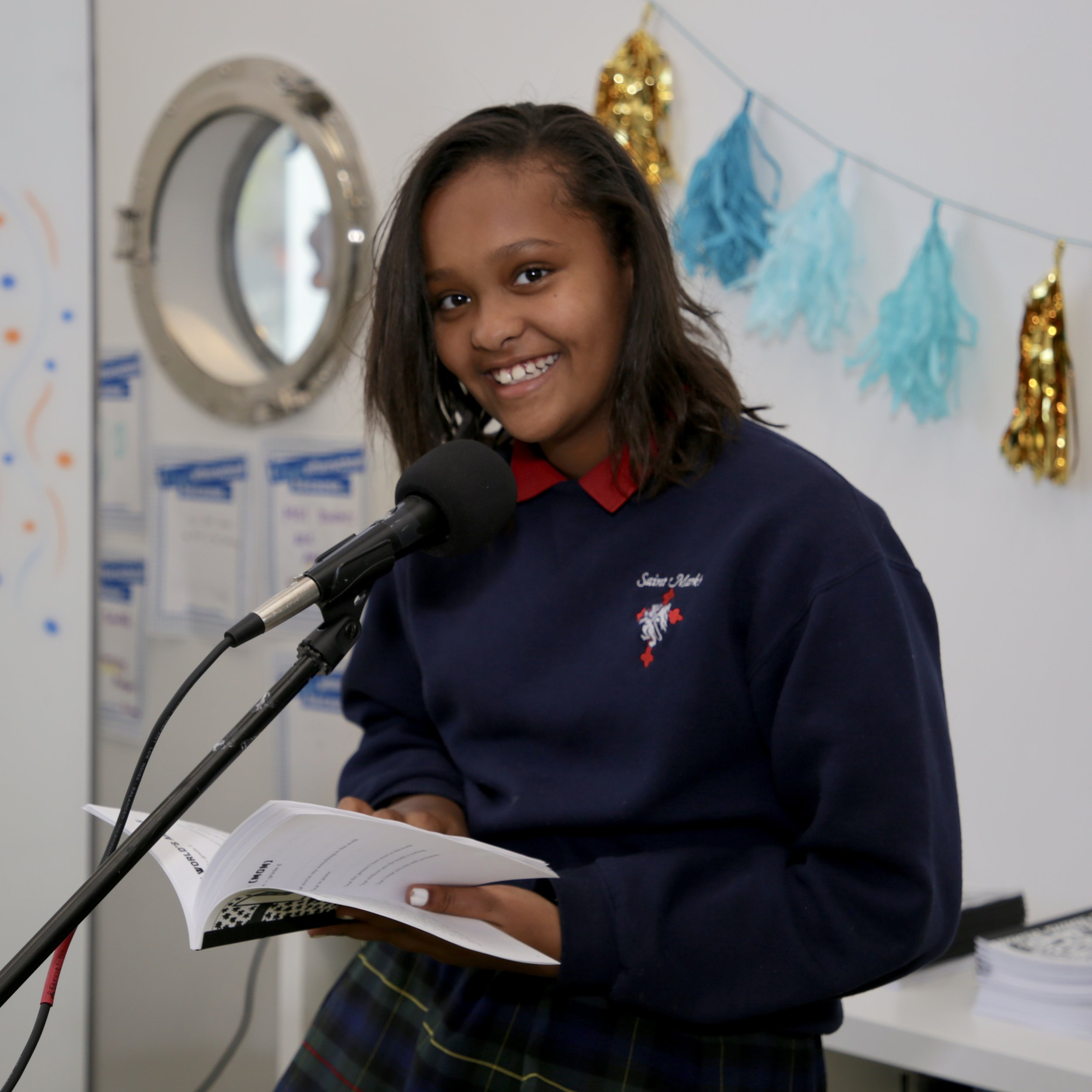 Selama reading her recently published works at the After-School Homework Help chapbook release party.