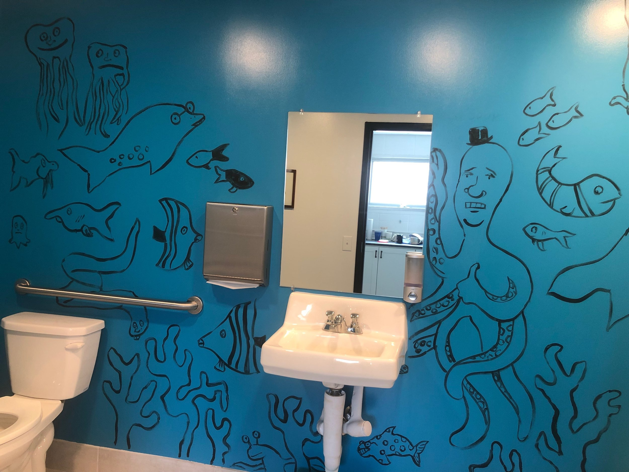 This is MOI's bathroom after Dave Egger's visited and helped raise money for the next program year.