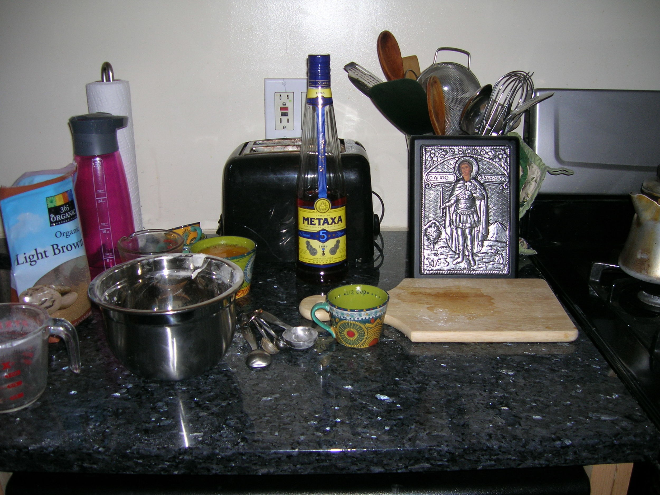 I was drinking water from the pink bottle. The Metaxa brandy was for the cake. ;)