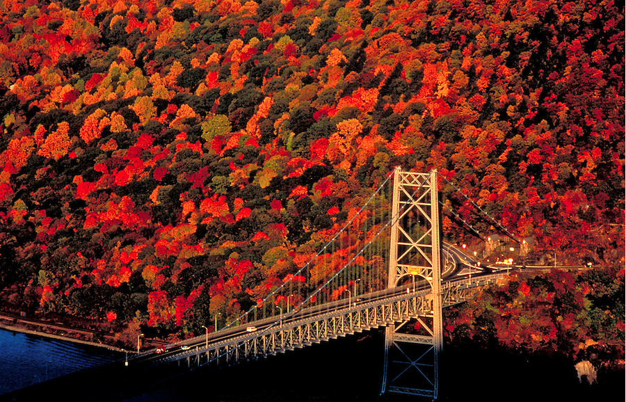 Bear Mountain Bridge across the Hudson, with fall colors, New York.   © Jake Rajs 2009