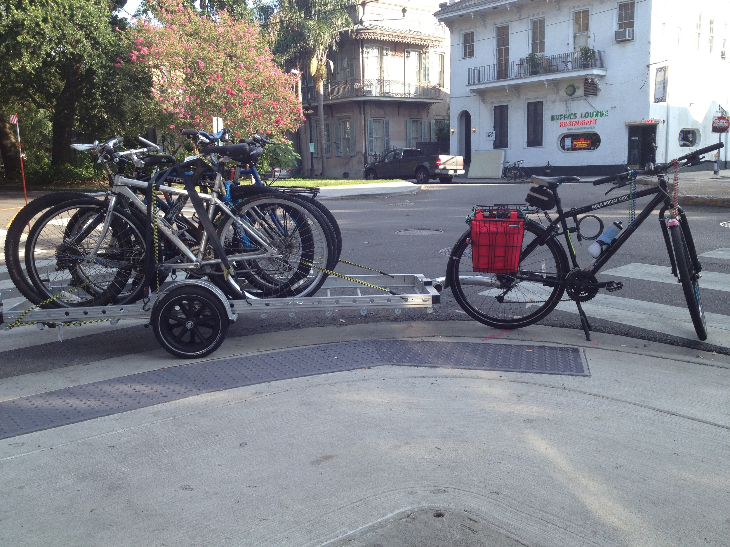 Four bikes on the trailer.  Picture taken in front of Buffas Lounge