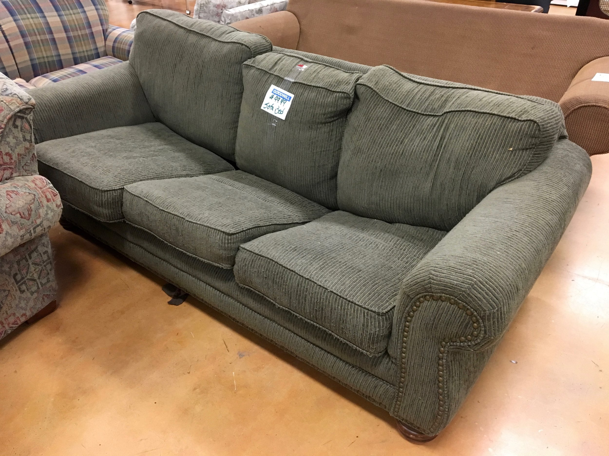 The sofa for sale at Goodwill on Tulane but without the mattress.