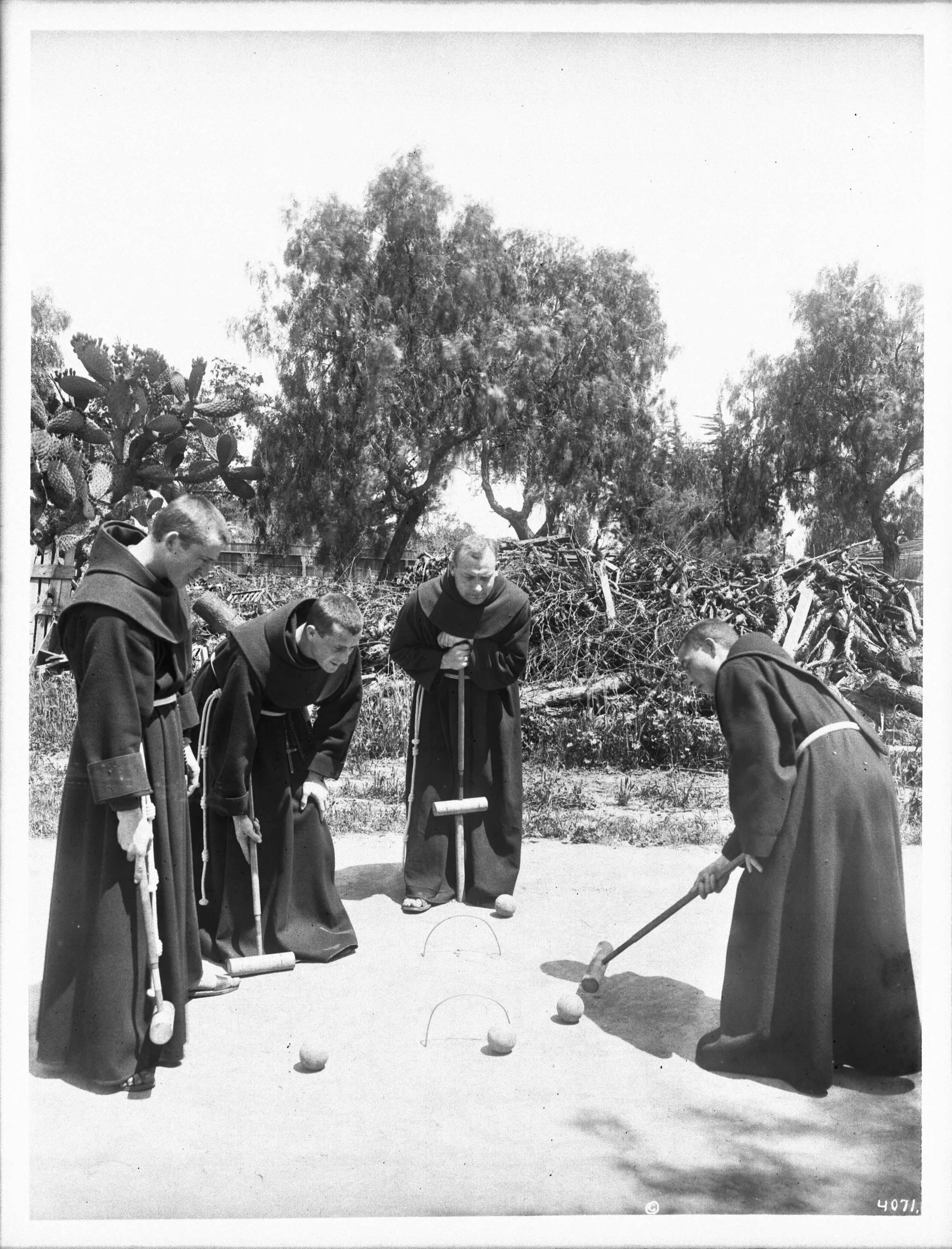 Four_Franciscan_monks_playing_croquet_at_Mission_Santa_Barbara,_ca.1904_(CHS-4071).jpg