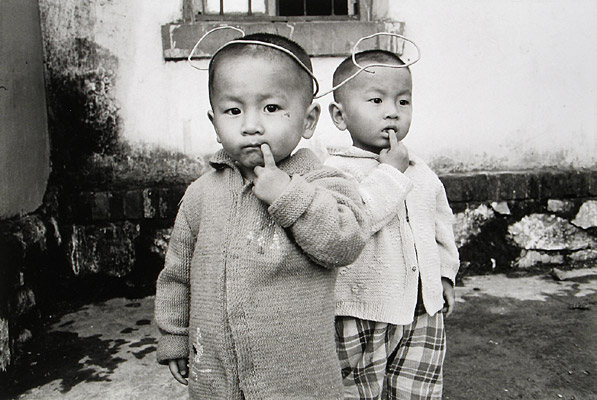 Young Boy with Mickey Mouse Ears, China