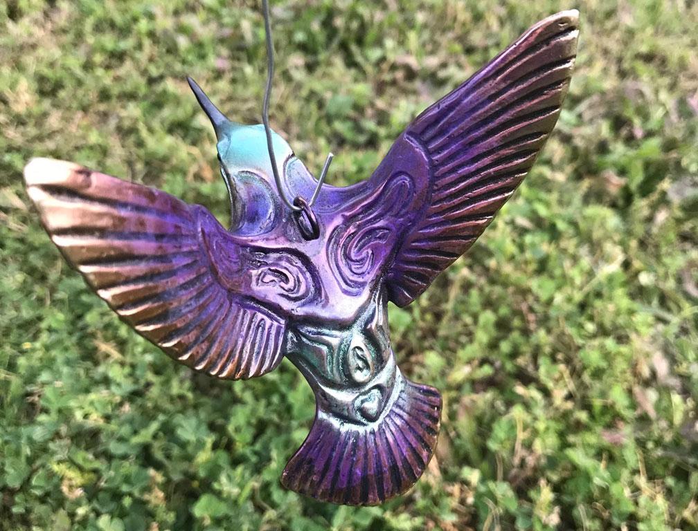 bronze hummingbird sculpture by john maisano