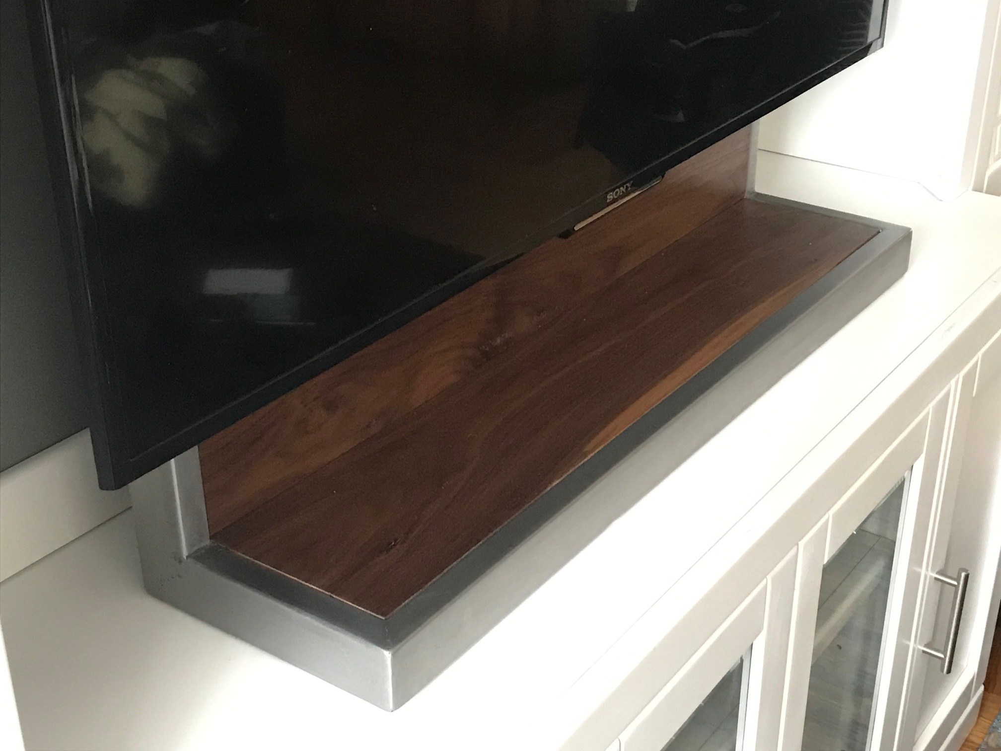 A TV stand designed and built by Dennis