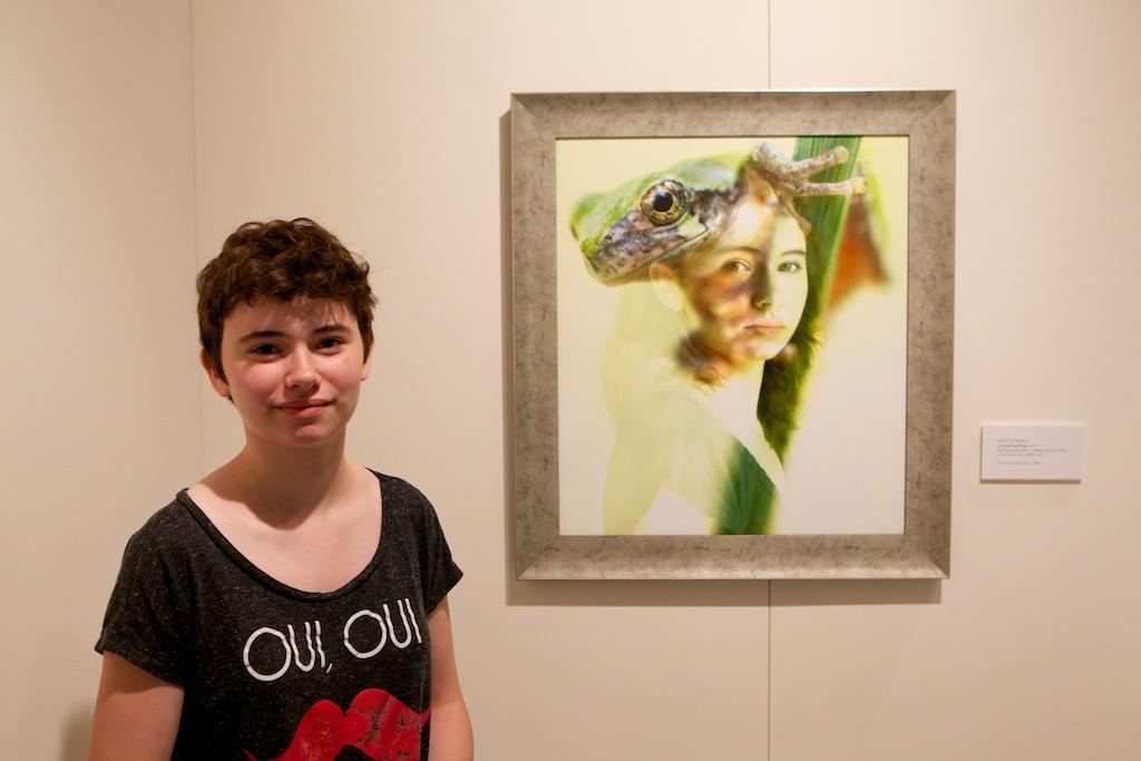 Lois Rustenholtz herself, standing next to her portrait