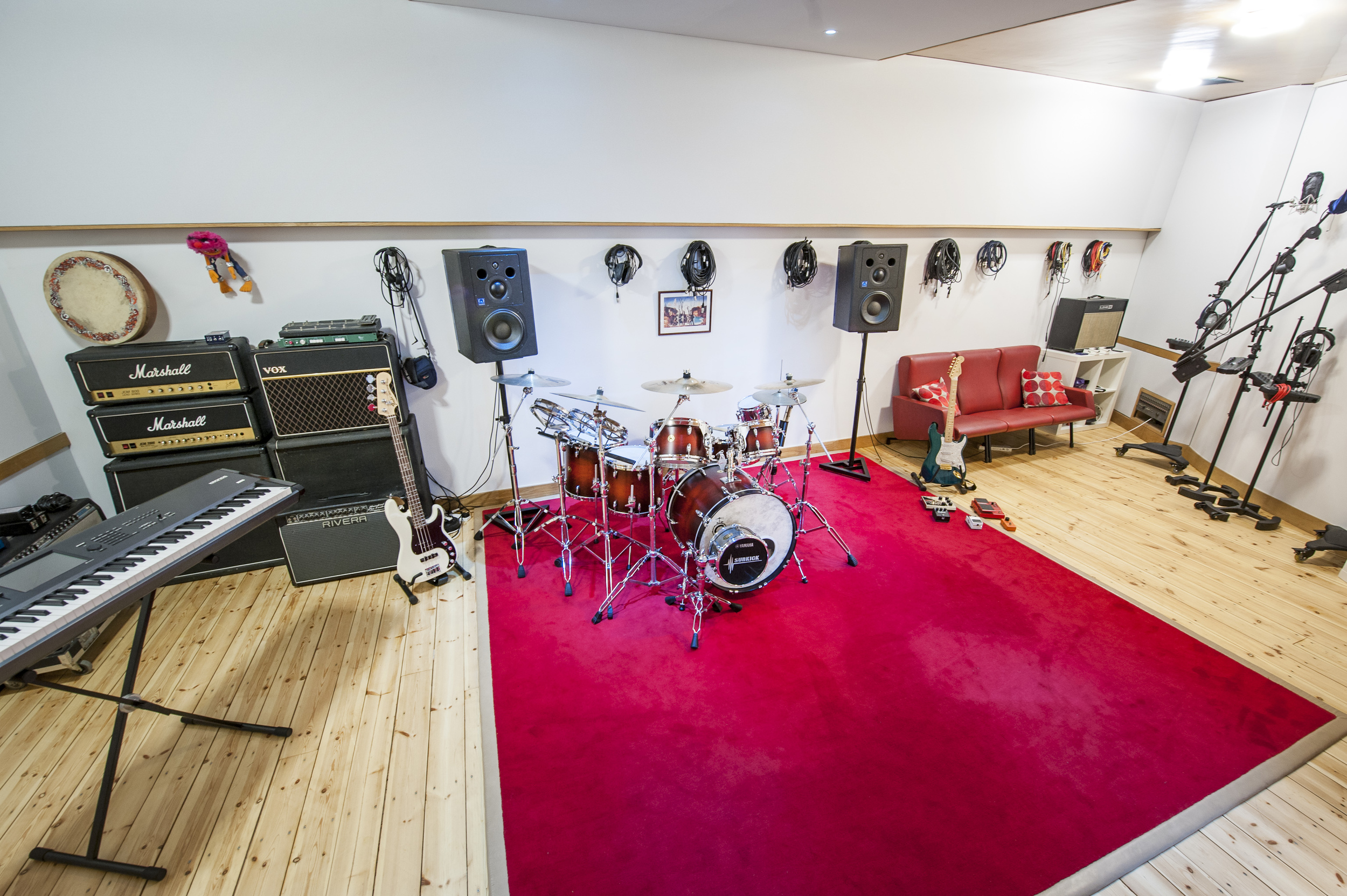 Live Room with a selection of new and vintage guitar and bass amps, pedals, drum kits and percussion
