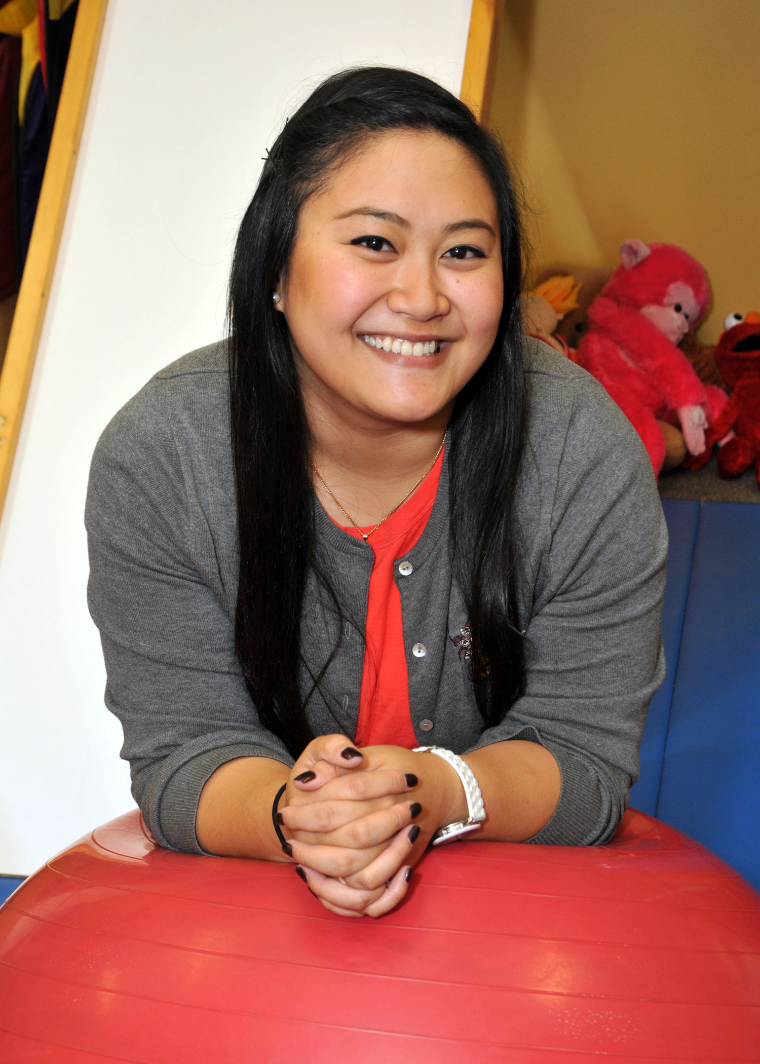 Thao Witbeck, MS, CCC-SLP/L - Thao was born and raised in the Lake County area. She has been married to her college sweetheart, Cameron, for 3 years. In her spare time, Thao loves to spend time with her family, friends, and her dog, Loki. When she can, she loves to travel, especially to Marquette in the Upper Peninsula of Michigan, where she attended college, or to Vietnam to visit her Dad's family. She enjoys singing for fun and has sung the national anthem in front of a crowd of 900 people! Thao likes to watch reality competition shows and anything 'Gordon Ramsey.'For her undergraduate degree, she ventured to Michigan, where she received her bachelor's degree from Northern Michigan University in Speech, Language and Hearing Sciences. She received her master's degree in Communication Disorders from Minot State University, in North Dakota. Thao started at Pediatric Interactions when she was a graduate student intern and was happy to join the PI team after that. She has experience working with children in Early Intervention, Autism, Behavioral Management, Receptive/Expressive Language delays, Alternative/Augmentative Communication (AAC), and more. She also enjoys working with bilingual families. In the past year, she received training for the Pragmatic Organisation Dynamic Display (PODD), which is a low-tech communication device. She has been excited to share this information with others at PI.