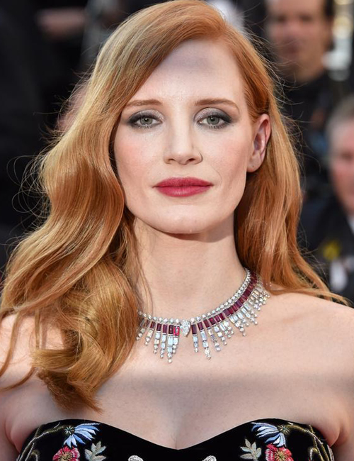 JESSICA CHASTAIN  wearing Piaget's Ruby and Diamond Sun On Fire Necklace