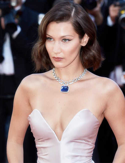 BELLA HADID  stuns in Bulgari's Il Magnifico platinum and diamond necklace that's set with the most breathtaking 180 carat cabochon sapphire.