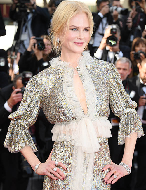 NICOLE KIDMAN  dazzles in Harry Winston jewels, 10.43 carat diamond Secret Cluster Diamond Earrings and 39.48 carat diamond Marquesa Double Row Diamond Bracelet.