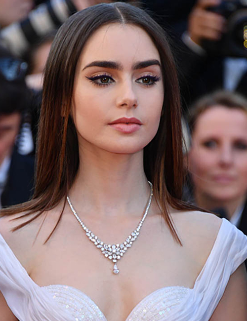 LILY COLLINS  embraces her inner princess in a Bulgari Diamond Necklace.