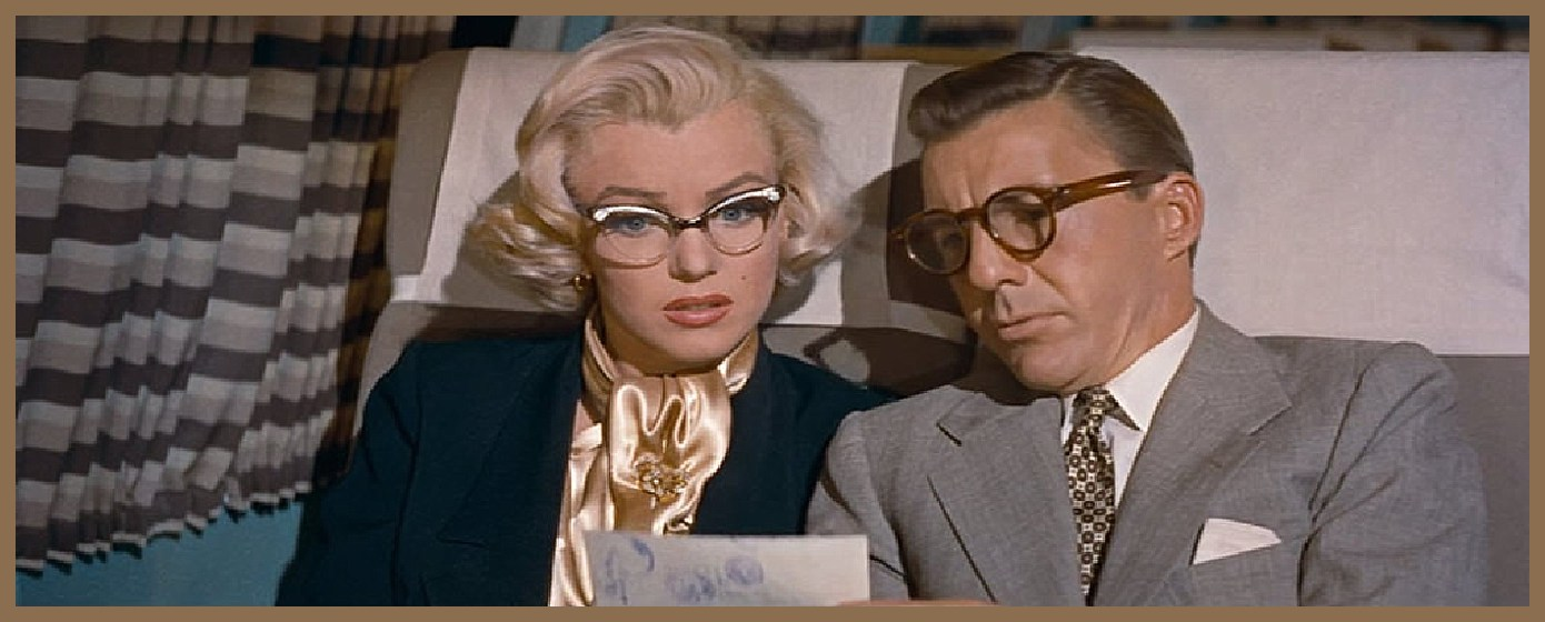 Marilyn Monroes's scarf highlights her hair while the glasses connect our eye to her jacket: nothing left to chance.