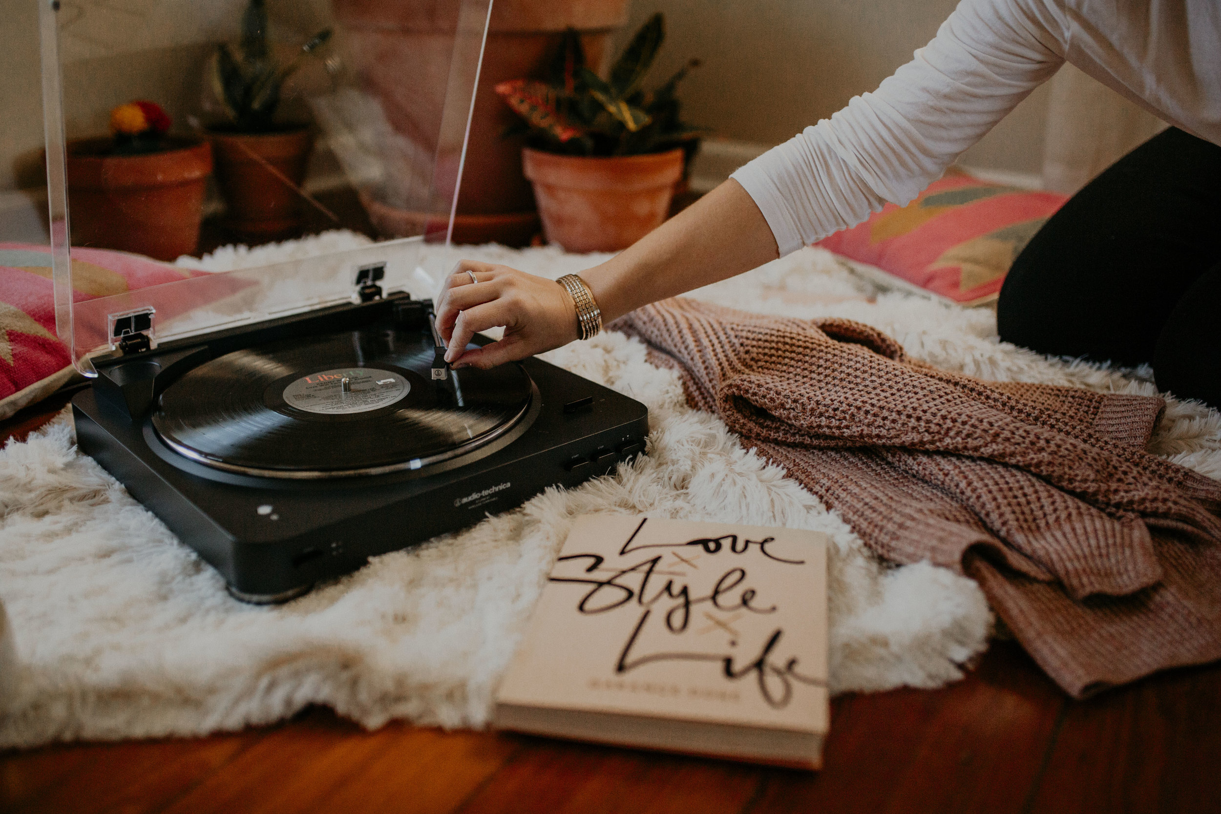 Shop the  record player ,  sweater ,  blanket  and  book from Urban Outfitters