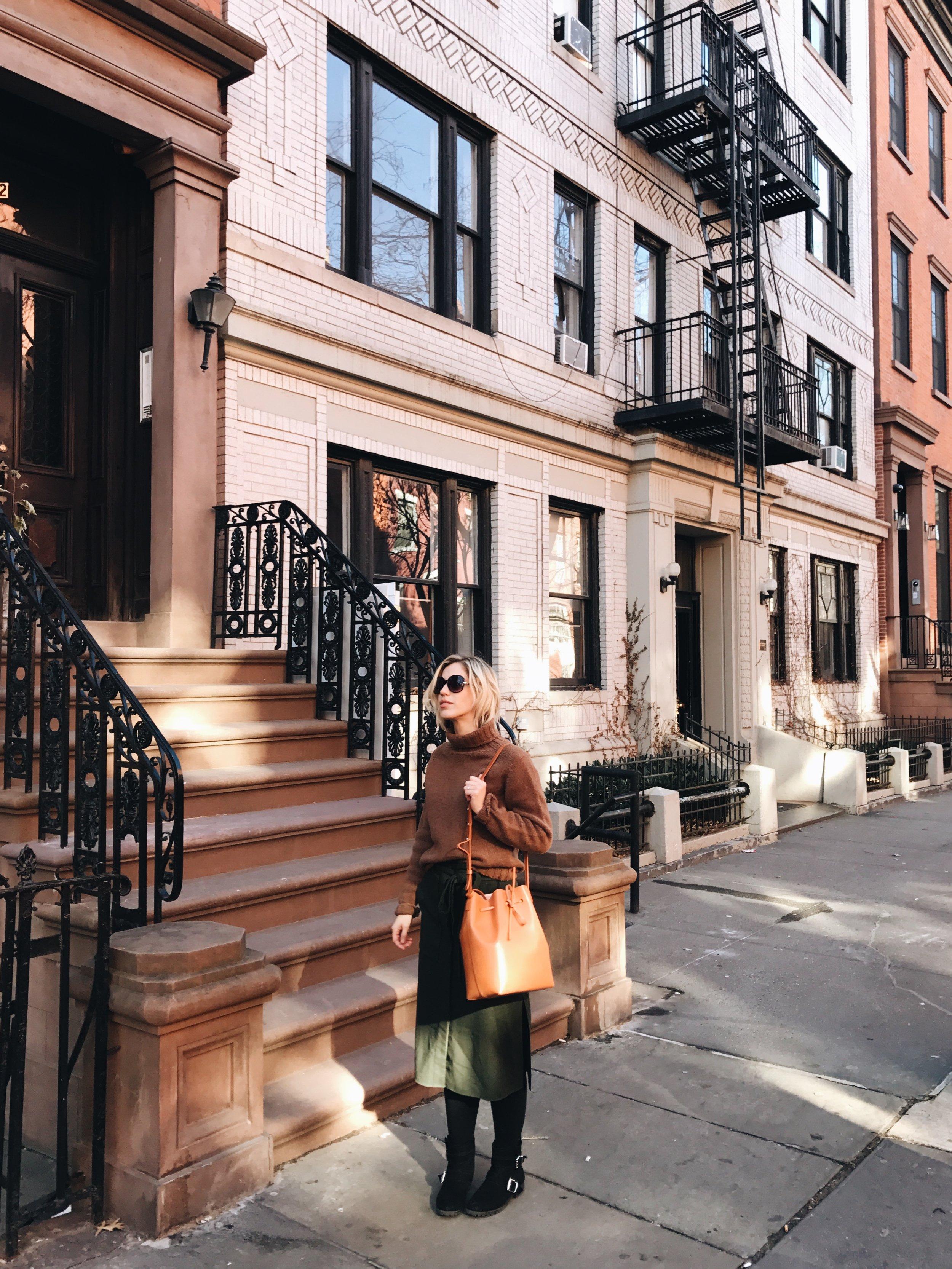 Wearing  Tibi skirt via Rent the Runway ,  Filson sweater ,  Mansur Gavriel bag