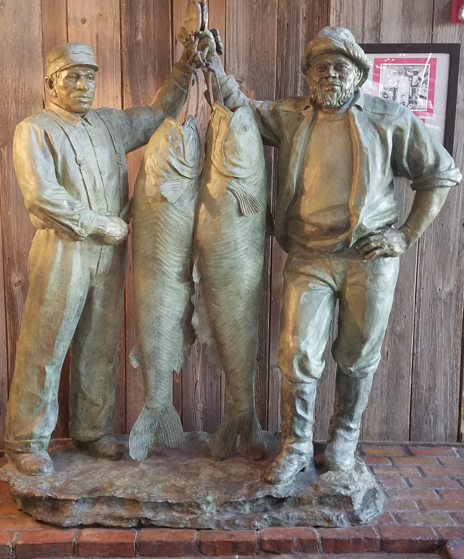 Abe Burns & Jake Washington - 92lb and 110lb Blue Catfish Bronze Sculpture Located inside Abe & Jake's Landing.