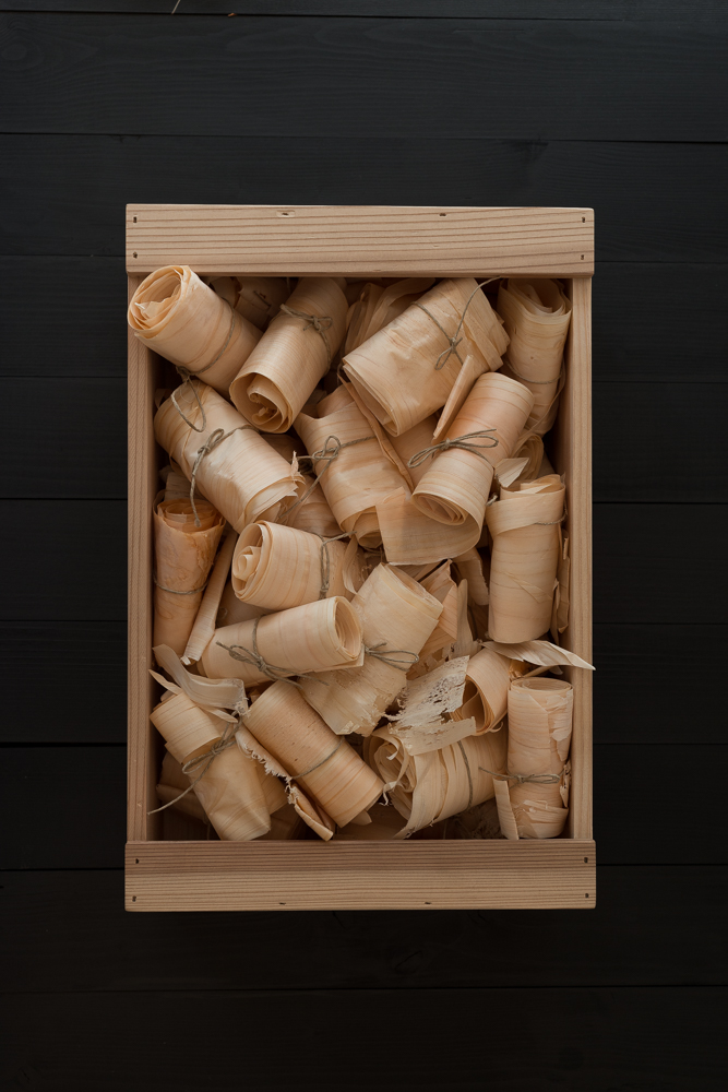 A carpenter's tool box filled with Hinoki wood shavings