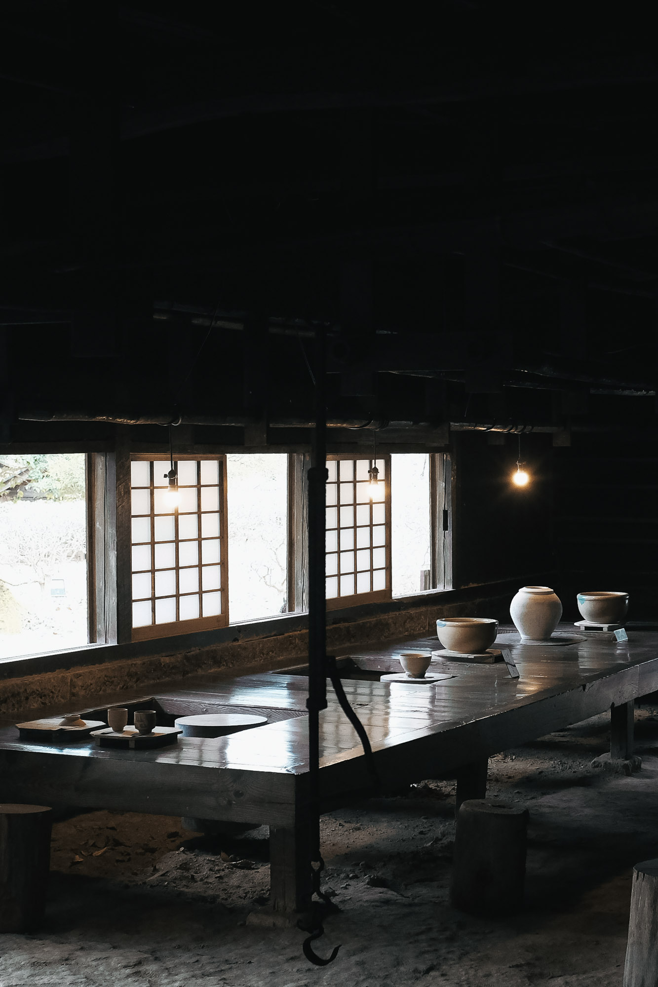 Hamada's pottery studio is adjacent to his home. He usually worked seated and would spin his potter's wheel with the help of a stick. The clay could then be shaped with his hands while there was still enough momentum in the wheel.