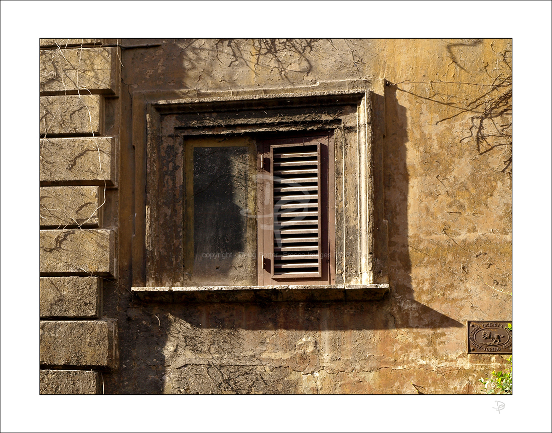 Shuttered window.