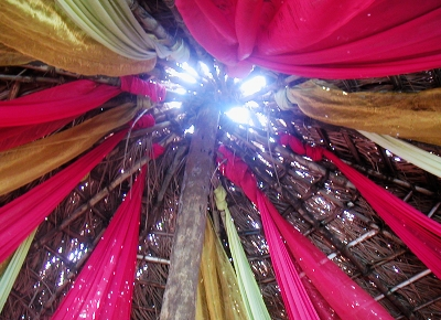 Silk streamers under the thatched roof in the lounge.